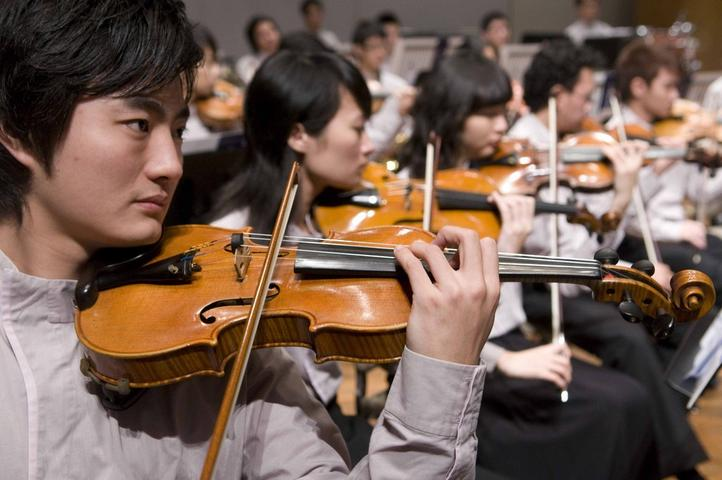 Snapshot of performers in an Asian Youth Orchestra